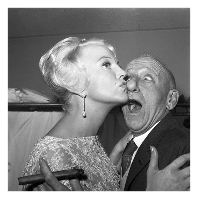 06 Feb 1961, New York, New York, USA --- Getting busted in the nose is nothing to sniff about, says Jimmy Durante, whose considerable schnozzle is smacked by shapely song star Peggy Lee. Both headliners are appearing in New York nightclubs: Jimmy at the Copecabana and Peggy at Basin Street East. --- Image by © Bettmann/CORBIS