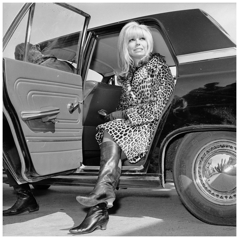 american-singer-nancy-sinatra-gets-out-of-a-car-wearing-a-leopard-skin-coat-and-knee-length-boots-photo-by-central-pressgetty-images-1966
