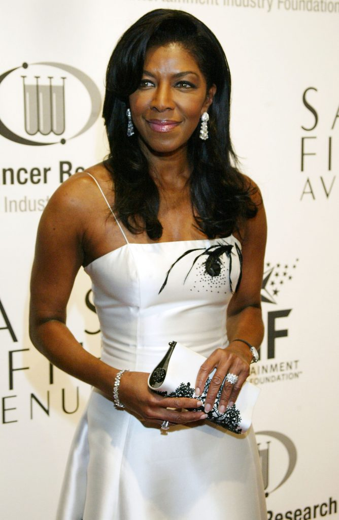 "BEVERLY HILLS, CA - MARCH 1: Singer artist Natalie Cole arrives at the ""Saks Fifth Avenue's Unforgettable Evening"" at the Regent Beverly Wilshire on March 1, 2004 in Beverly Hills, California. Nicole Kidman was honoured by the Women's Cancer Research Fund, a program of the Entertainment Industry Foundation (EIF). (Photo by Doug Benc/Getty Images)"