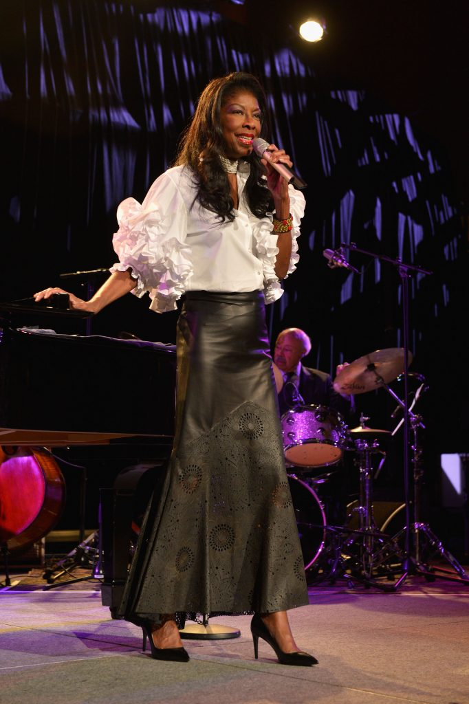 "NEW YORK, NY - OCTOBER 07: Singer Natalie Cole performs onstage at Tony Bennett and Susan Benedetto's ""Exploring the Arts Gala"" to support arts education in public high schools at Cipriani, Wall Street on October 7, 2013 in New York City. (Photo by Larry Busacca/Getty Images for Exploring the Arts)"
