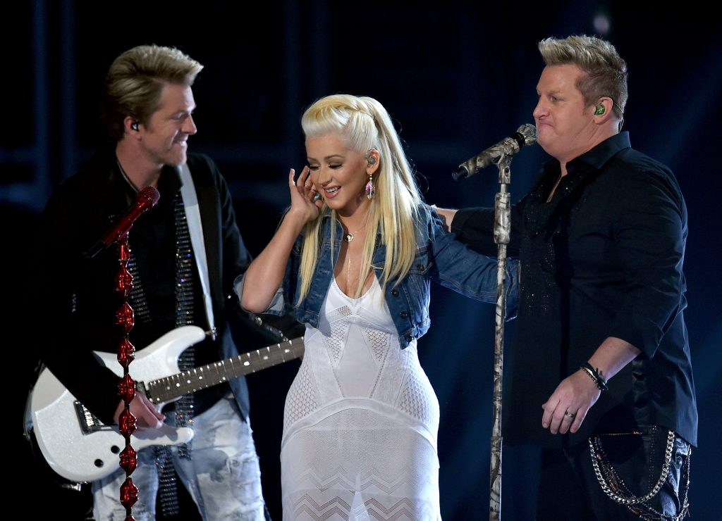 ARLINGTON, TX - APRIL 19: (L-R) Musicians Joe Don Rooney of Rascal Flatts, Christina Aguilera and Gary LeVox of Rascal Flatts perform onstage during the 50th Academy Of Country Music Awards at AT&T Stadium on April 19, 2015 in Arlington, Texas. (Photo by Ethan Miller/Getty Images for dcp)
