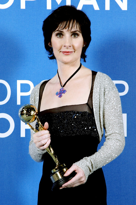 LONDON - NOVEMBER 15: Irsih singer Enya poses for a picture backstage in the awards room with the Best-selling Irsih Artsist Award during the 2006 World Music Awards at Earls Court on November 15, 2006 in London. (Photo by Gareth Cattermole/Getty Images)